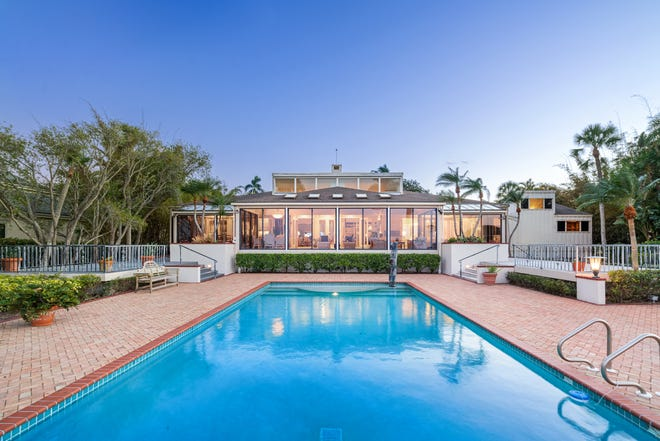 The Stanley and Janet Kane waterfront estate on Siesta Key in Bay Island is on the market for $8.2 million.  (Denis Lauzon Photo & Video Productions)
