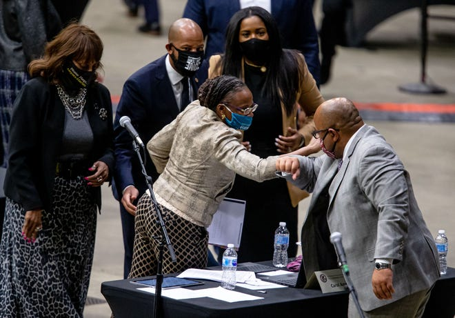 Illinois State Rep. Carol Ammons, D-Urbana, gets an elbow bump from Illinois State Rep. AndrŽ Thapedi, D-Chicago, after passage of the Illinois Black Caucus' Education Pillar, HB 2170, during the lame-duck session for the Illinois House of Representatives held at the Bank of Springfield Center, Monday, January 11, 2021, in Springfield, Ill. [Justin L. Fowler/The State Journal-Register]