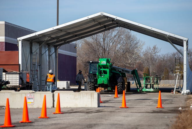 Construction has begun on a prefabricated building that will be used to administer COVID-19 vaccines in a drive-thru system at the Sangamon County Department of Public Health on Tuesday in Springfield. [Justin L. Fowler/The State Journal-Register]