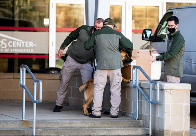 The Illinois State Police use a dog to check containers being delivered to the Bank of Springfield Center during the lame-duck session for the Illinois House of Representatives on Tuesday in Springfield. JUSTIN L. FOWLER/THE STATE JOURNAL-REGISTER