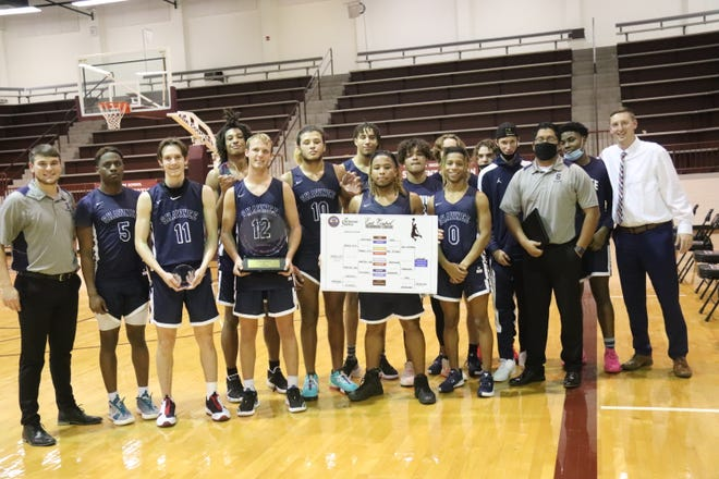Members of the Shawnee High School boys' basketball team pose with their trophy Saturday after winning the championship of the East Central Oklahoma Classic at Ada.