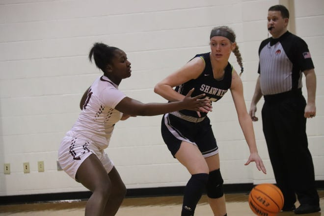 Shawnee's Aubrie Megehee (right) tries to shield the Ardmore defender from the ball during the third-place game Saturday of the East Central Oklahoma Classic at Ada High School. Megehee, who collected 16 points in the game, was named to the all-tournament team.