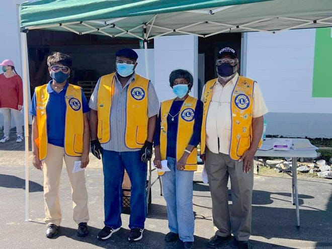The Jones County Lions Club earned a Membership Satisfaction Award from Lions International in December 2020. The award is given when a club meets expectations of its members by offering meaningful and relevant service to the community. Pictured are Lions Gladys Meadows, Billy Murphy, Edna Murrell and John Cooper volunteering at the Jones County Food Pantry. [CONTRIBUTED PHOTO]