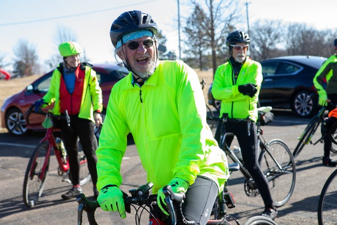 Bill Lucero smiles before departing Tuesday afternoon from Tinman Circle at Lake Shawnee with the Ol' Phogey group ride. Lucero started the group ride after seeing a need for bringing senior cyclists together back in 2011 and now is up to 500 consective rides since.