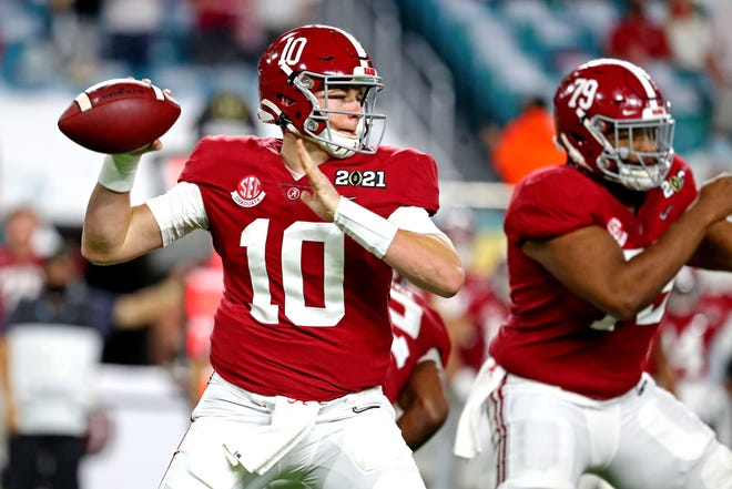 Alabama's Mac Jones was college football's most efficient passer and led the nation with 4,500 passing yards and a 77.4% completion rate.
