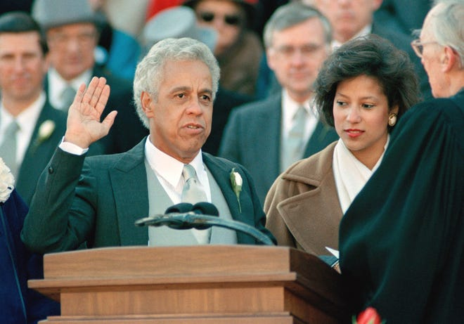 L. Douglas Wilder is sworn in as the 66th governor of Virginia during a ceremony outside the Capitol in Richmond January 13, 1990. Wilder became the first elected black governor of the United States. Former governor Gerald Baliles is at right.