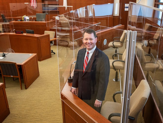 WORCESTER - Clerk Magistrate Brian M. D'Andrea stands in the Central District Court jury box with new dividers on Tuesday.