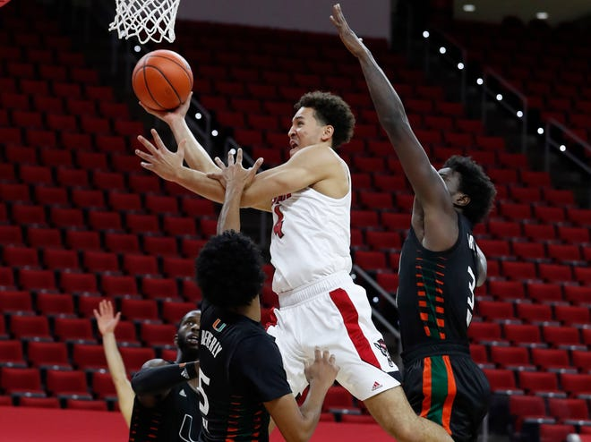 Jericole Hellems, center, and the NC State men's basketball team will look to snap a two-game losing streak Wednesday at Florida State.