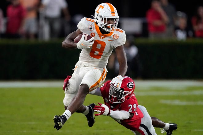 Tennessee running back Ty Chandler, left, breaks away from Georgia defensive back Christopher Smith after making a catch in an October game this past season.