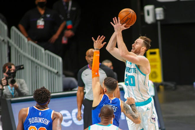 Charlotte Hornets forward Gordon Hayward (20) shoots over New York Knicks guard Austin Rivers in the first quarter of an NBA basketball game in Charlotte, N.C., Monday, Jan. 11, 2021. (AP Photo/Nell Redmond)