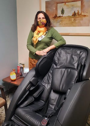 Kara Crites stands next to the new massage chair in the zen room she helped established for her coworkers at St. Thomas More Hospital in Canon City.