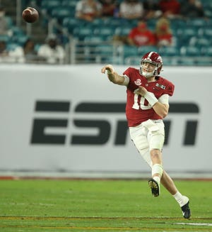 Jan 11, 2021; Miami Gardens, Florida, USA;  Alabama quarterback Mac Jones (10) throws on the run against Ohio State in the College Football Playoff National Championship Game in Hard Rock Stadium. Mandatory Credit: Gary Cosby-USA TODAY Sports