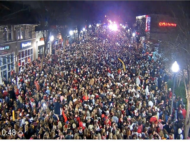 Fans rush onto University Boulevard in Tuscaloosa, Ala., after the University of Alabama won the College Football Playoff on Jan. 11.