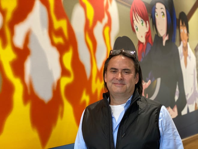 Darrell van Ligten, Genjigo chief executive officer, stands in front of a mural at the new Westerville location, 14 E. Schrock Road.