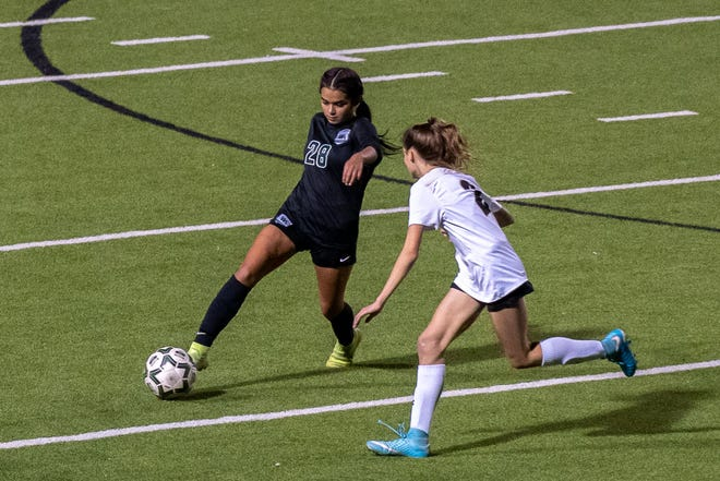 Waxahachie's Bella Curiel (28) makes a move during a district match against Mansfield last season. Curiel scored a hat trick in Thursday's 7-0 win against Richardson High in the Battle of 287 Tournament, and led the Lady Indians to a 3-0 finish.