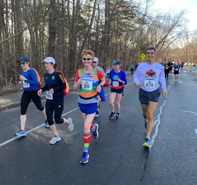 Carol Chaoui, third from left, in the Resolution Run to Kick Cancer race in 2020. This year's race is dedicated to Chaoui.