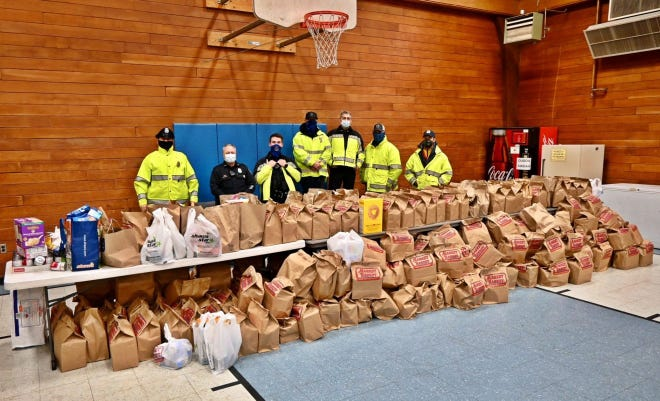 Members of the Newburyport Police Department collected over $7,000 in donated food, cash and gift cards to benefit the Salvation Army's food pantry this holiday season.