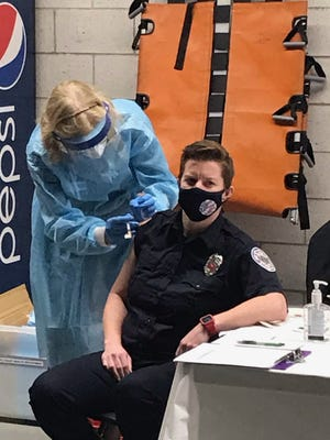 Cancer survivor Joanie Cullinan, finally back at her job as a Wellesley firefighter, gets her first shot.