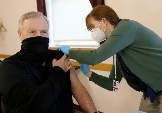 Patrolman Steve Howard got his Moderna COVID-19 vaccine from Heidi Doreau, Nurse Practitioner at Emerson Hospital, Jan. 12, 2021.