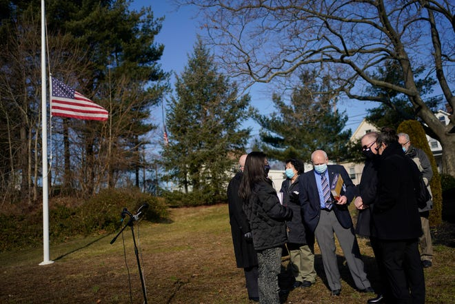 Friends and family of U.S. Capitol Police Officer Brian Sicknick, including his father Charles Sicknick, center right, gathered Tuesday for a short ceremony to honor his life in his hometown of South River, N.J.