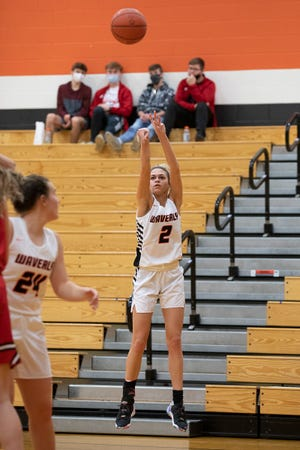 Waverly's Carli Knight makes a three-point shot during the fourth quarter of Waverly's game against South Webster. Waverly defeated South Webster 50-49 in overtime.