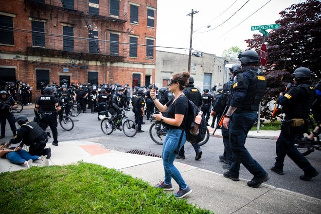 Enquirer reporter Madeline Mitchell covers the protest in Cincinnati in June 2020 following the death of George Floyd in Minneapolis.
