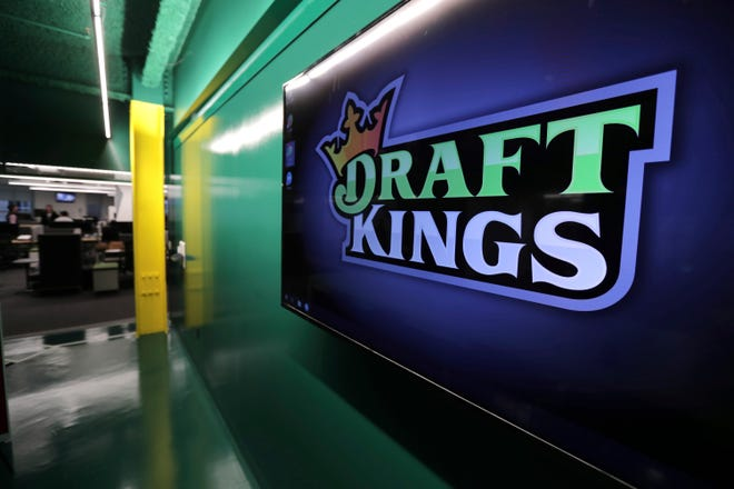 DraftKings logo is displayed at the sports betting company headquarters in Boston.