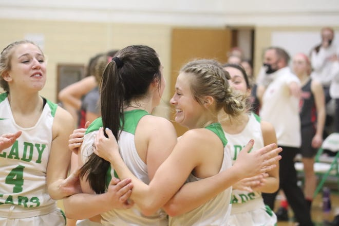 Margaretta's Elliana Schaefer, right, hugs Kylie Leibacher after Liebacher sank the game-winning free throw.