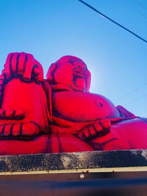 The Buddha statue's new, bright-red paintjob debuted last month at Buddha LIVE nightclub. It's since been toned down with black shading.