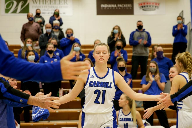 Carroll's Megan Wagner (21) is introduced before the first quarter of an IHSAA girls basketball game, Monday, Jan. 11, 2021 in Flora.