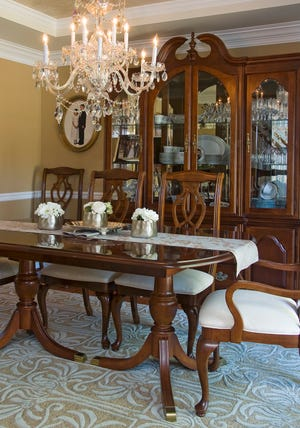 The dining room in this East Louisville home boasts a Swarovski crystal chandelier.