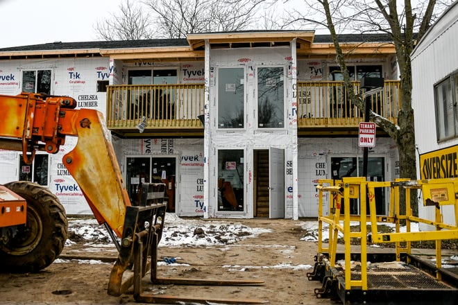 Renovations are underway on Tuesday, Jan. 12, 2021, in Stockbridge, at the Lakewood Apartments that were damaged in a fire last year.