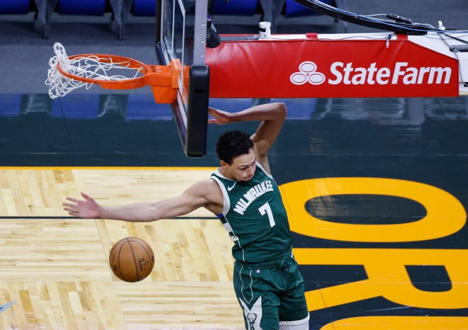 Bucks guard Bryn Forbes finishes a dunk in the fourth quarter Monday night.