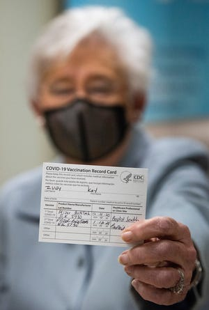 Alabama Governor Kay Ivey shows her vaccine card after she received her second COVID-19 vaccine shot at Baptist Medical Center South in Montgomery, Ala., on Tuesday January 12, 2021.