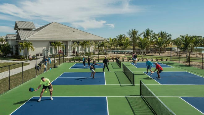 The new amenity center with Pickleball quad courts at Antilles.