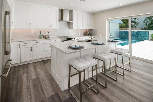Perfect for entertaining friends and family, the villa features an open-concept floor plan that combines living, dining, and kitchen areas that optimize living space.