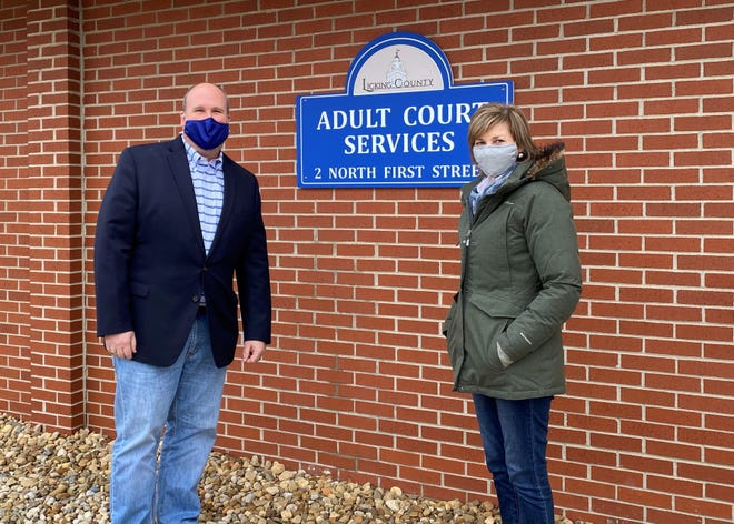 Licking County Adults Court Service Administrator Scott Fulton (left) and Director Michele Hamann (right) pose for a photo outside the Adult Court Services building on Friday, Jan. 8, 2021.