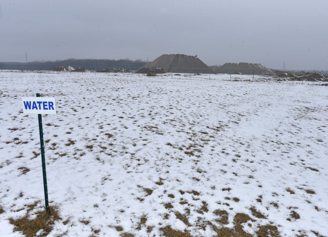 Wixom has plenty more room to add more business development at its Assembly Park - particularly to the north of Menards. Acres of space is still available and a huge mountain of pulverized concrete, center, is all that remains of the former Ford Wixom plant.
