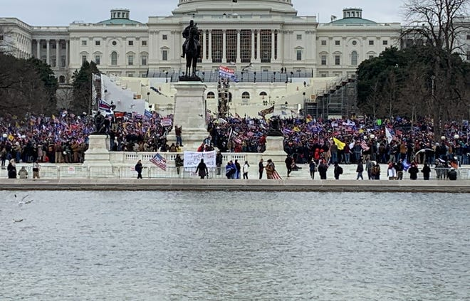 Protesters ascend around the U.S. Capitol building Wednesday, Jan. 6, 2021, in Washington, D.C.