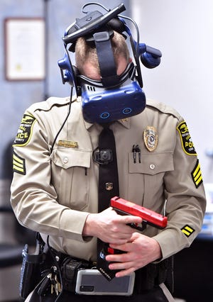 Northern York County Regional Police Department Sgt. Cody Becker participates in WRAP Reality training at the department Monday, Jan. 11, 2021. Bill Kalina photo