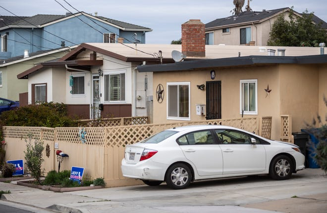 Two Jeff Gorman signs are placed in front of a home that was searched by FBI agents in Seaside, Calif., on Tuesday, Jan., 12, 2021.