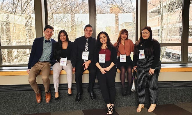Adrian Hall, third from left, is a student at Grand Valley State University in Michigan, and is shown here with other members of Laker Familia, a program that helps Hispanic and Latinx students build a network on campus.