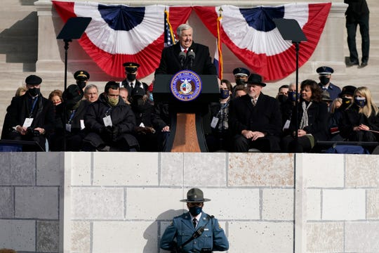 Missouri Gov. Mike Parson delivers his inaugural address Monday in Jefferson City, Mo., after being sworn into his first full term as governor, while a member of the Missouri Highway Patrol stands below.