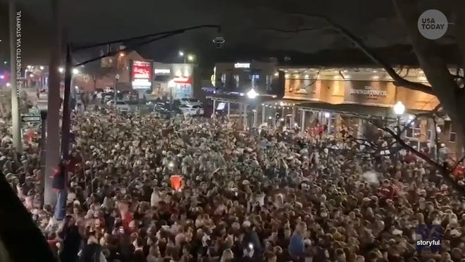 Alabama fans packed the streets of Tuscaloosa to celebrate the Crimson Tide's 52-24 national championship win against Ohio State.