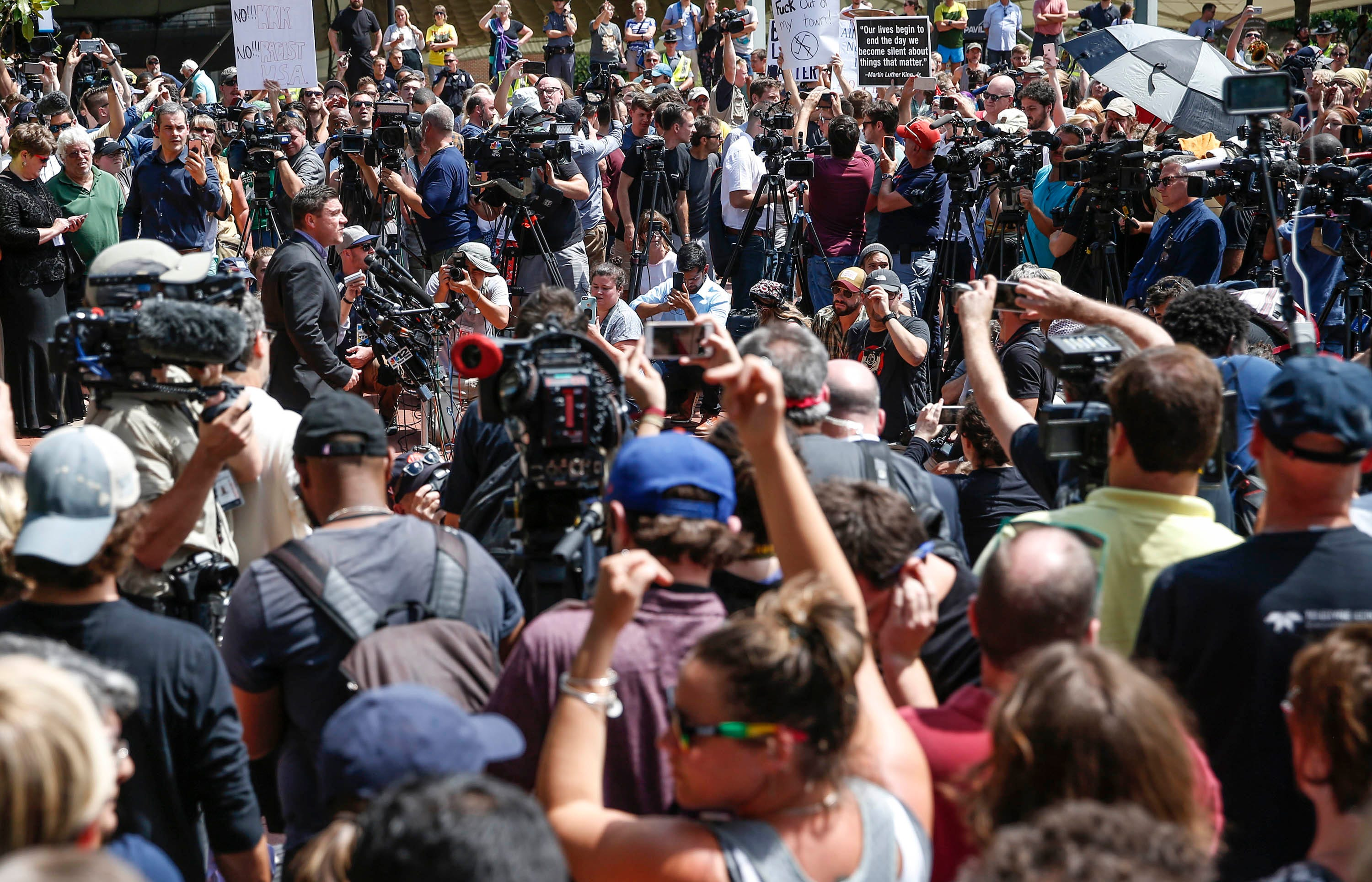 Aug 13, 2017; Charlottesville, VA, USA;  'Unite the Right' rally organizer and white nationalist Jason Kessler speaks to a large crowd gathered at Charlottesville City Hall. Crowd members played loud instruments and yelled as to drown out his voice. Mandatory Credit: Mykal McEldowney/IndyStar via USA TODAY NETWORK ORIG FILE ID:  20170813_lbm_usa_075.JPG