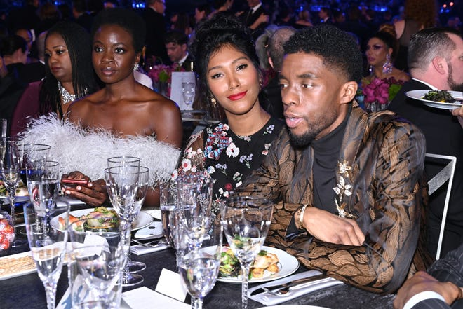 Danai Gurira, left, Taylor Simone Ledward and Chadwick Boseman at the 2019 Screen Actors Guild Awards.