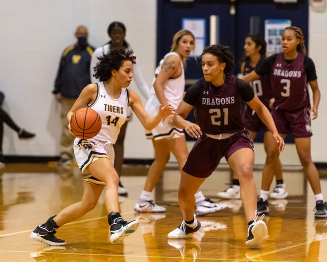 Stony Point point guard Ariana Rosado looks for an opening against Round Rock's Bailey Featherstone in Stony Points' 67-62 win in a District 25-6A basketball game Tuesday at Stony Point High School.