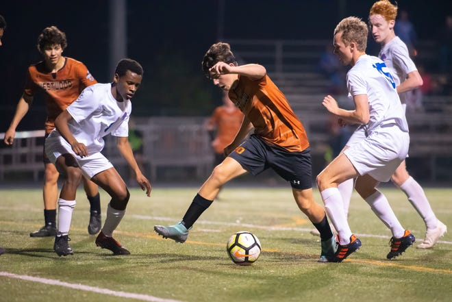 Niko Djordjevic of Westwood, dribbling through multiple Leander defenders in a match last season, enters his fourth year on varsity with high hopes of a playoff run.