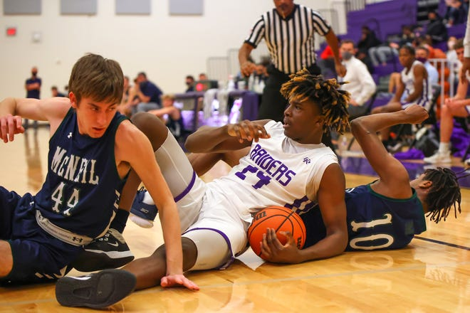 Cedar Ridge post Marcel Bryant collects a loose ball rebound in the second half of a District 25-6A game against McNeil Jan. 12 at Cedar Ridge High School. Cedar Ridge won their fifth straight game, 67-41 over McNeil.