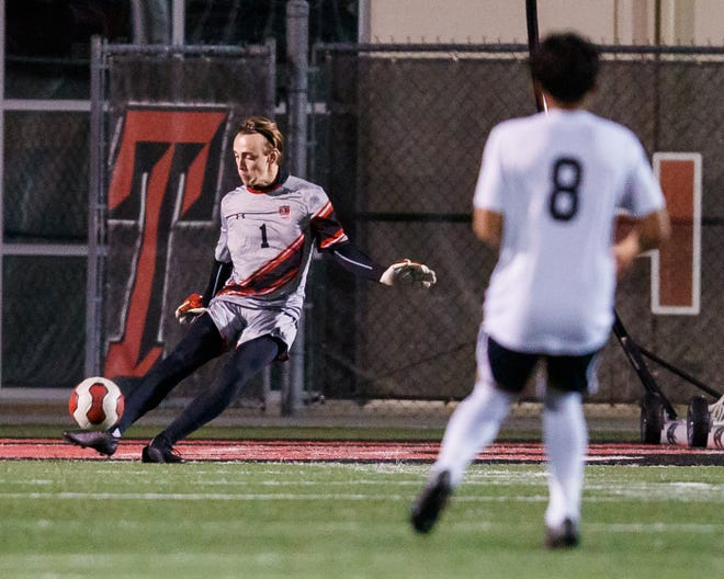 Lake Travis goalie Drew Snodgrass sends the ball downfield in a match against Del Valle last season. Snodgrass returns in goal for a deep and talented Cavalier squad that tops the Stateman's preseason poll.